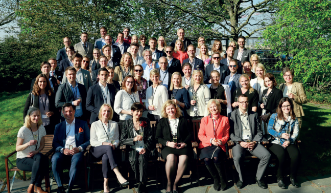 Picture of attendees at the international alumni day in Stockholm taken outside in the garden