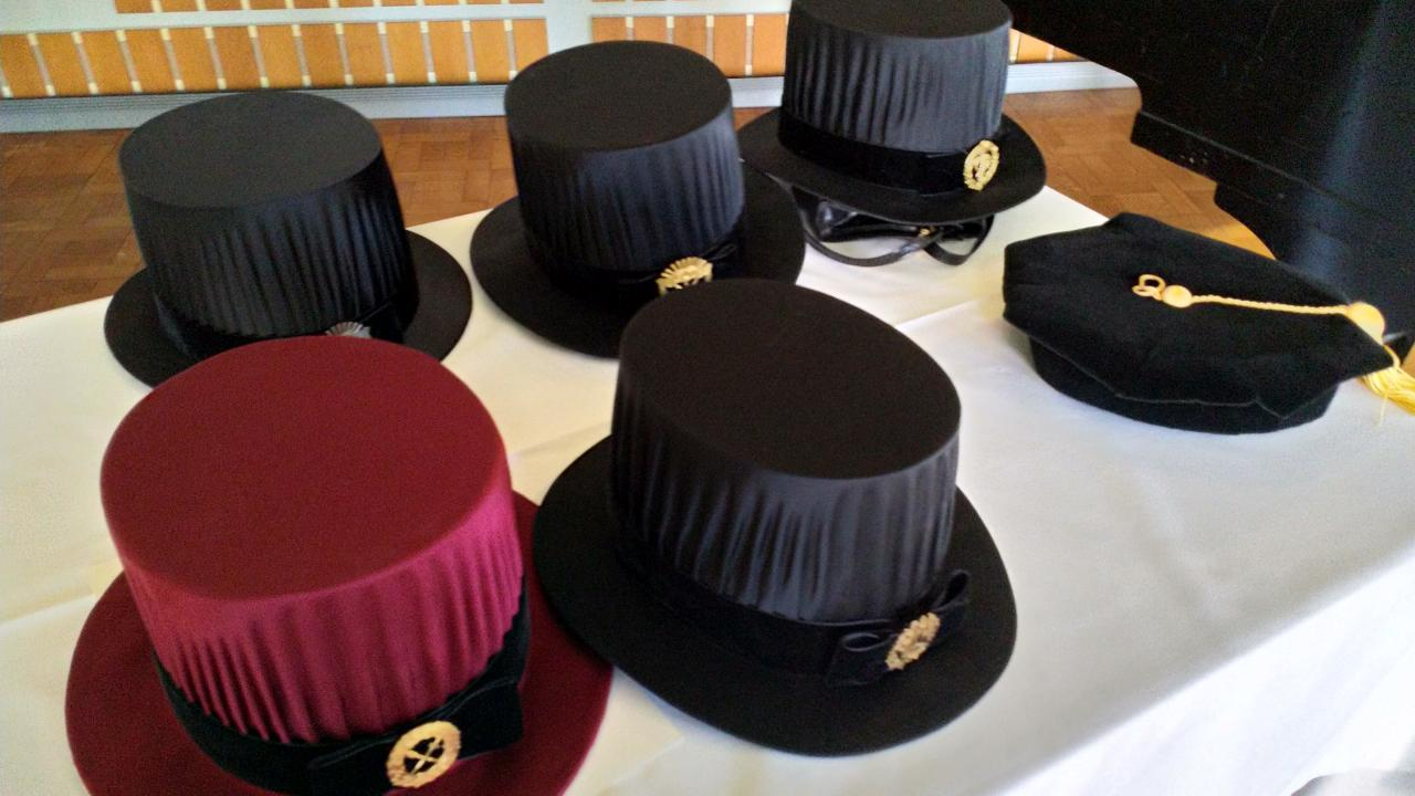 Table set with a few doctoral hats
